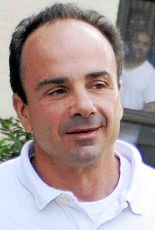 FILE - In this July 19, 2010 file photo, former Bridgeport Mayor Joseph Ganim leaves a halfway house in Hartford, Conn. Ganim was sentenced to nine years in prison in 2003 for corruption, and was released in 2010 after serving almost seven years. Photo: AP / AP2010