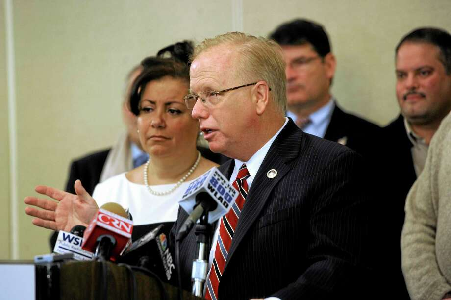 "Danbury Mayor Mark Boughton, center, with his wife Phyllis at his side, announces his intention to run for governor during a news conference Wednesday, Jan. 8, 2014, in Danbury, Conn. The seven-term mayor said Wednesday he's seeking the Republican party's nomination this year because he believes Connecticut residents are not ""getting their fair share of the American dream."" (AP Photo/The News-Times, Carol Kaliff) Photo: AP / The News-Times"