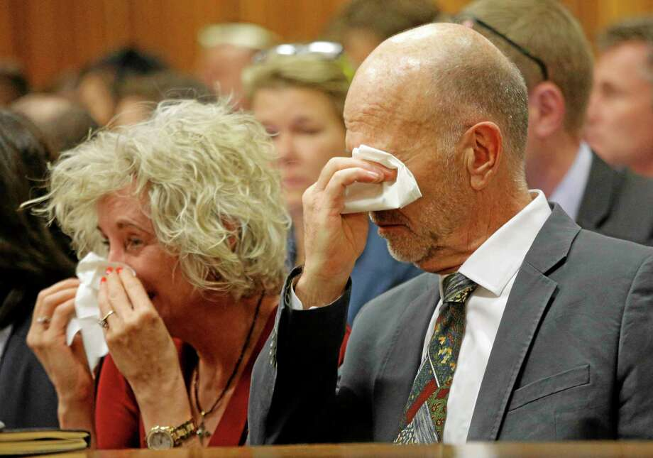 Family members of Oscar Pistorius, including uncle Arnold Pistorius, right, cry as they listen to Oscar Pistorius testifying in court in Pretoria, South Africa, Tuesday, April 8, 2014. Pistorius is charged with the murder of his girlfriend Reeva Steenkamp, on Valentines Day 2013. (AP Photo/Kim Ludbrook, Pool) Photo: AP / POOL EPA