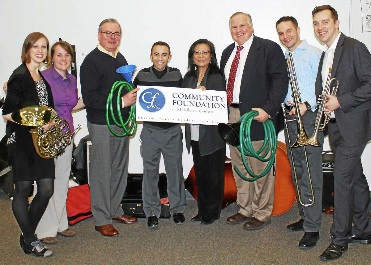 From left are Leelanee Sterrett (artist), Kimberly Everson (band teacher), Peter Amos (EWS board president), Tony Pandolfe (band teacher), Mihae Lee (artistic director), Marco Gaylord (Director of Fine Arts and District Operations), Stephen Dunn (artist) and Paul Murphy (artist).