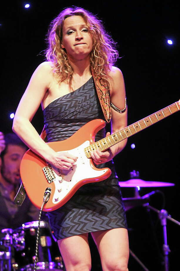 Photo by John Atashian Serbian blues guitarist and singer Ana Popovic is shown soloing on her guitar for the capacity crowd of fans at Infinity Music Hall in Norfolk on Saturday April 5. Ana is currently on tour in support of her ninth album ìCan You Stand The Heatî. To learn more about Ana Popovic you can visit www.anapopovic.com Photo: Journal Register Co.