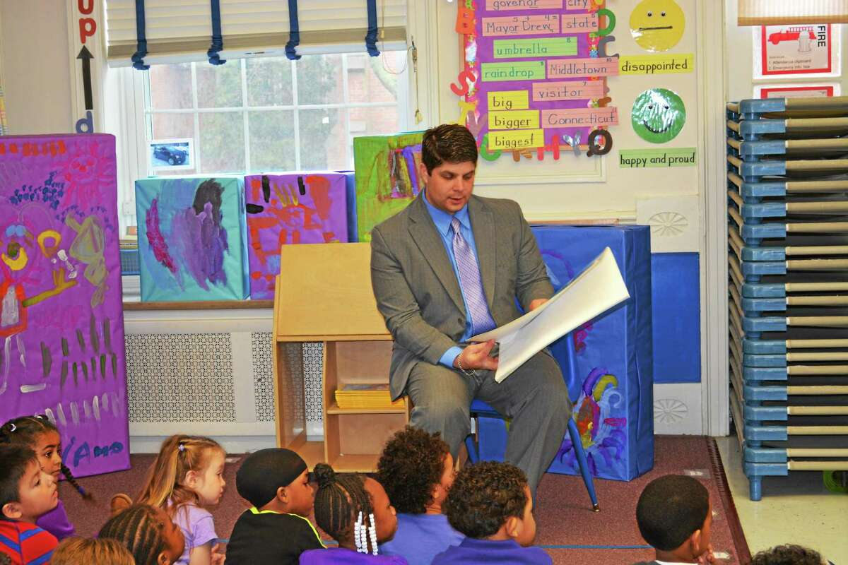 Mayor Dan Drew reads to preschoolers at the Middlesex County YMCA Tuesday to help celebrate the Week of the Young Child and raise awareness for the importance of preschool.