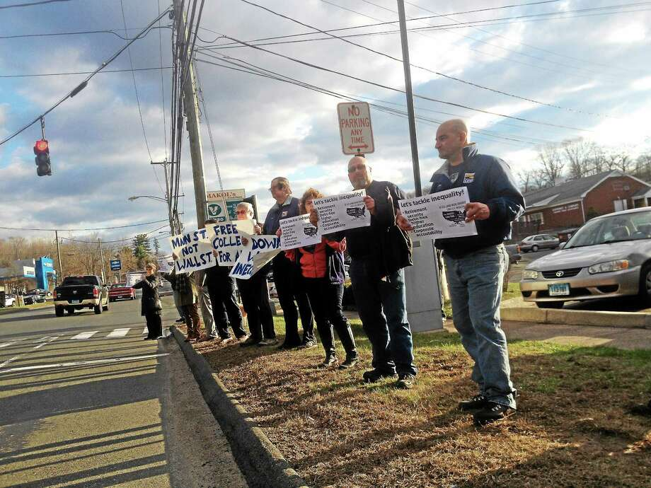 Protesters rally Tuesday in Middletown. Photo: Alex Gecan — Middletown Press