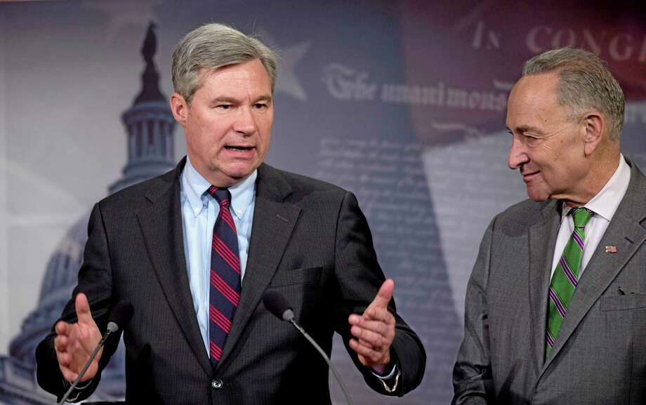 Sen. Sheldon Whitehouse, D-R.I. left, accompanied by Sen. Charles Schumer, D-N.Y., speaks to reporters on Capitol Hill in Washington, Wednesday, April 2, 2014, about the Supreme Court decision in the McCutcheon vs. FEC case, in which the Court struck down limits in federal law on the aggregate campaign contributions individual donors may make to candidates, political parties, and political action committees.  (AP Photo/Manuel Balce Ceneta) Photo: AP / AP