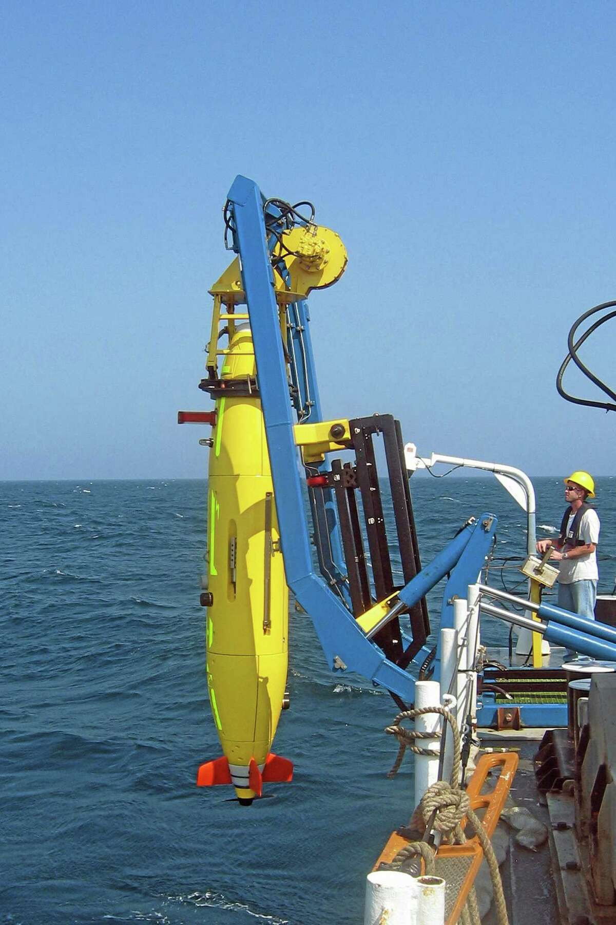 This undated photo provided on April 1, 2014 by Hydroid via the Woods Hole Oceanograhic Institute shows the REMUS 6000 unmanned sub being launched. Unmanned subs, also called autonomous underwater vehicles or AUVs, played a critical role in locating the wreckage of the lost Air France jet, two years after it crashed in the middle of the south Atlantic. The find allowed searchers to recover the black boxes that revealed the malfunctions behind the tragedy. (AP Photo/Hydroid)