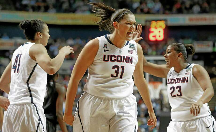 Connecticut center Stefanie Dolson (31) celebrates against Stanford during the first half of the semifinal game in the Final Four of the NCAA women's college basketball tournament, Sunday, April 6, 2014, in Nashville, Tenn. (AP Photo/John Bazemore) Photo: AP / AP