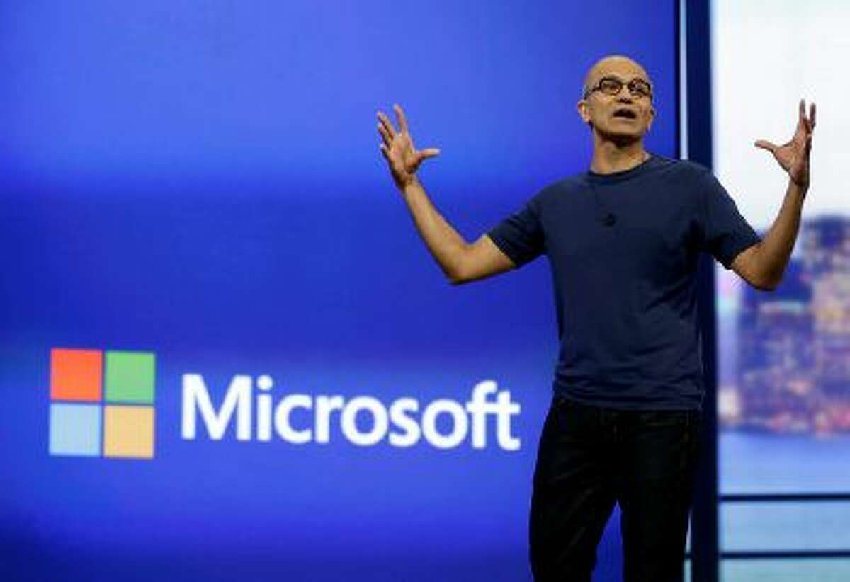 Microsoft CEO Satya Nadella gestures during the keynote address of the Build Conference Wednesday, April 2, 2014, in San Francisco. Microsoft kicked off its annual conference for software developers, with new updates to the Windows 8 operating system and upcoming features for Windows Phone and Xbox. (AP Photo/Eric Risberg)