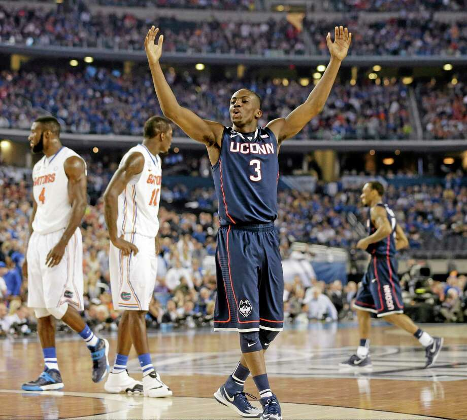 Connecticut guard Terrence Samuel celebrates against Florida during the second half of the NCAA Final Four tournament college basketball semifinal game Saturday, April 5, 2014, in Arlington, Texas. (AP Photo/Eric Gay) Photo: AP / AP