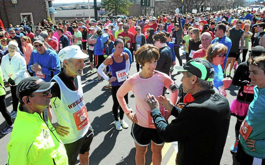 Harvard Pilgrim Half & Legends 4 Mile road race in Middletown. Legendary runners Amby Burfoot, second from left, and Jeff Galloway, right, chat with racers before the start of the race. Photo: Mara Lavitt — New Haven Register  / Mara Lavitt