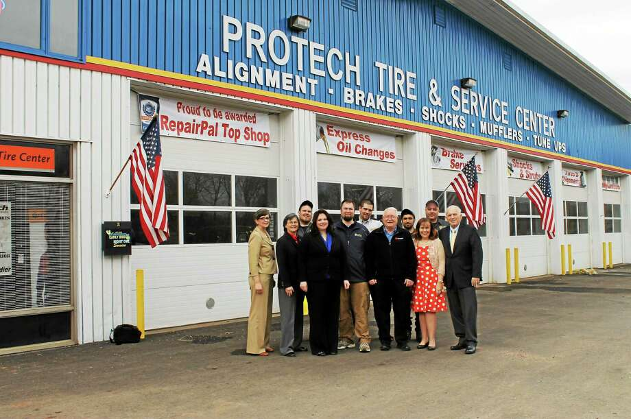 From left: Portland Economic Development Coordinator Mary Dickerson, Chamber Chairwoman Darlene Briggs, Rich Randall, Jamie Callinan, Matt Callinan, Rob Walton and Tim Callinan and Tristan Bush of ProTech Automotive, Portland First Selectwoman Susan Bransfied, Darryl Ziemba of ProTech and Chamber President Larry McHugh. Photo: Submitted Photo