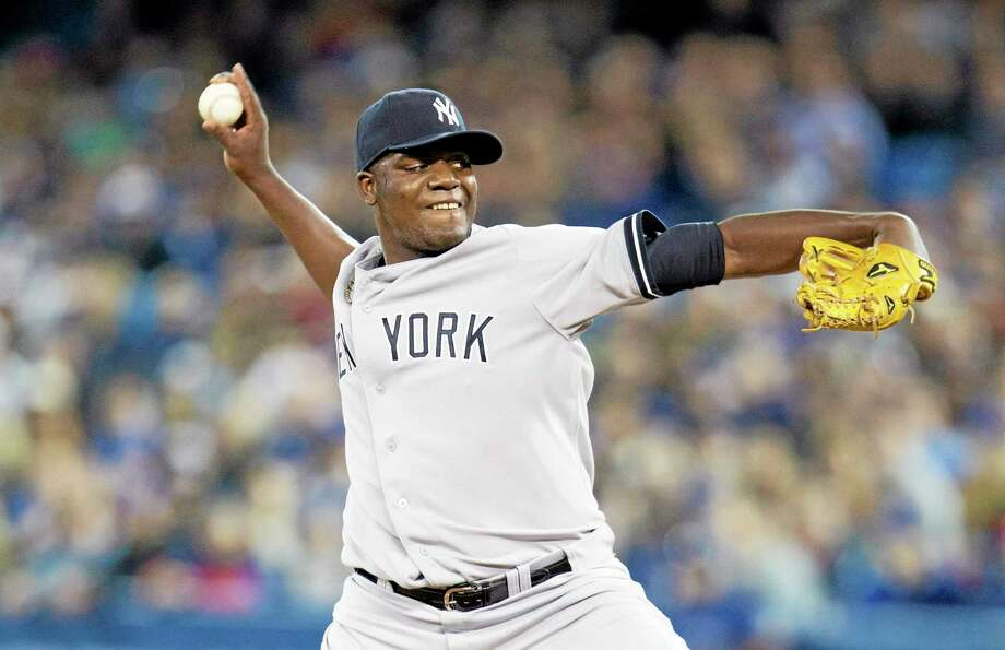 Yankees starting pitcher Michael Pineda throws during the first inning Saturday. Photo: Peter Power — The Associated Press  / The Canadian Press