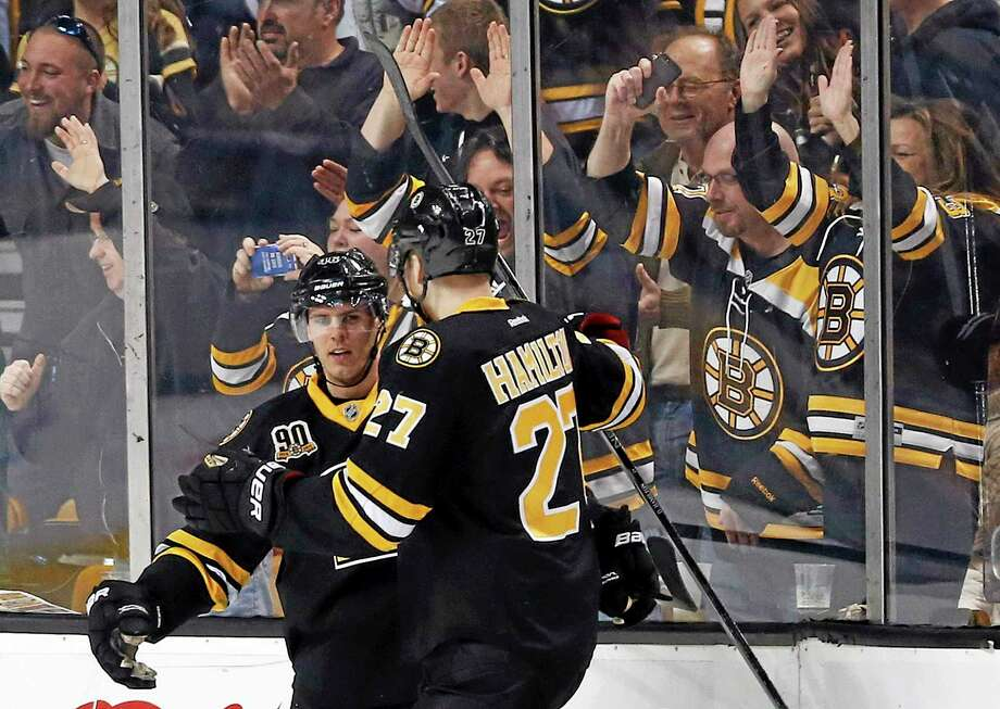 The Bruins' David Krejci, left, celebrates his goal with teammate Dougie Hamilton in the first period Saturday. Photo: Michael Dwyer — The Associated Press  / AP