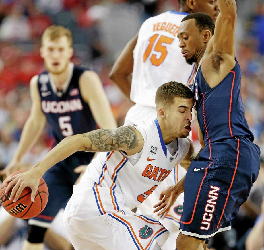 Florida's Scottie Wilbekin runs into UConn's Ryan Boatright during the first half of the Huskies' 63-53 win in the national semifinals at the Final Four on Saturday night in Arlington, Texas. Photo: David J. Phillip — The Associated Press  / AP
