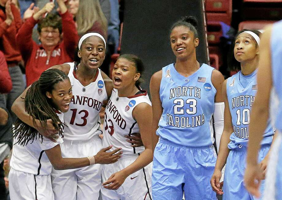 Stanford guard Lili Thompson, left, celebrates with forward Chiney Ogwumike (13) and guard Amber Orrange (33) during the second half of the Cardinal's 74-65 regional final victory over North Carolina on Tuesday in Stanford, Calif. Photo: Jeff Chiu — The Associated Press  / AP