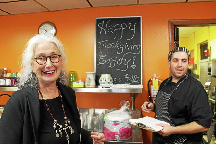Assistant Director Lydia Brewster, left, and chef Jeremiah Rufini, right, prepare for the serving of the St. Vincent de Paul's annual Thanksgiving meal in Middletown. Photo: Bob Walsh — Special To The Press