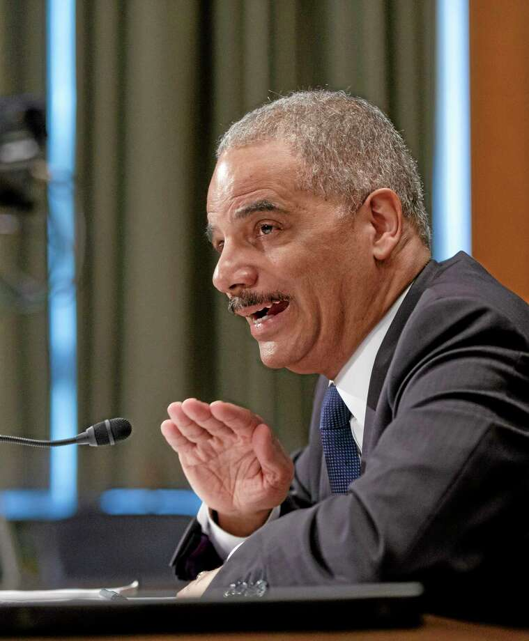 Attorney General Eric Holder testifies on Capitol Hill in Washington Thursday before a Senate Appropriations subcommittee on proposed budget estimates for fiscal year 2015 for the Justice Department. Photo: J. Scott Applewhite — The Associated Press  / AP
