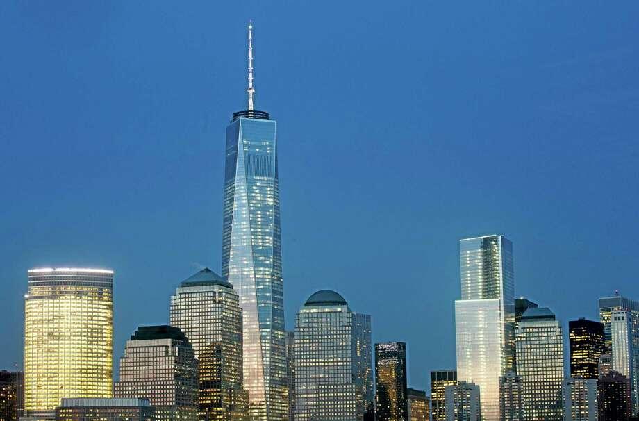 Goldman Sachs headquarters, left, One World Trade Center, second left, and 4 World Trade Center, center, stand above the lower Manhattan skyline Wednesday in New York. Photo: Mark Lennihan — The Associated Press  / AP