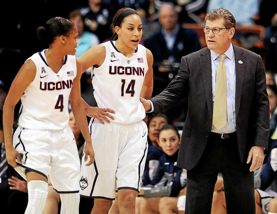 UConn head coach Geno Auriemma, right, speaks with Moriah Jefferson, left, and Bria Hartley during an AAC tournament game against Rutgers on March 9 in Uncasville. Photo: Jessica Hill — The Associated Press  / FR125654 AP