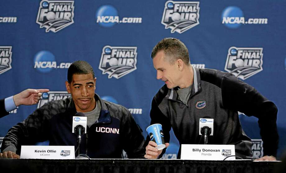 UConn head coach Kevin Ollie, left, will make $1.25 million this year. Florida head coach Billy Donovan, right, will make $3.9 million. The Huskies and Gators play each other Saturday with a berth in Monday's national championship game on the line. Photo: David J. Phillip — The Associated Press  / AP