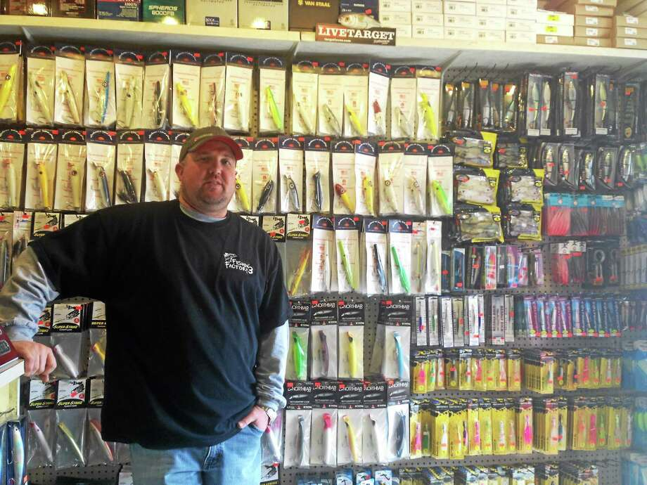 Andrew Nichols, owner of Fishin' Factory 3, is getting the shop ready for its biggest weekend, the opening weekend of trout season. Photo: Kaitlyn Schroyer — The Middletown Press