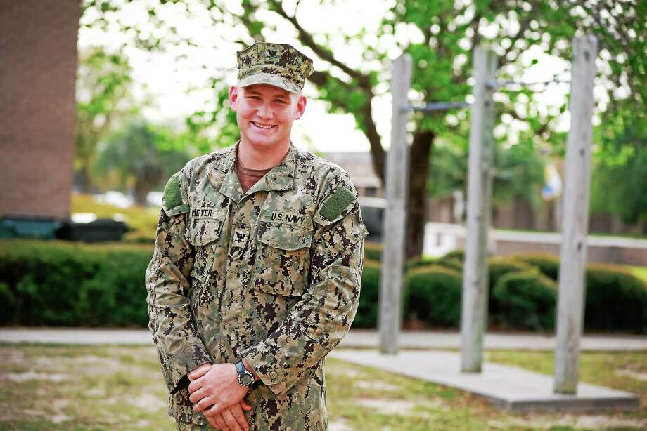 Courtesy Navy Outreach  2011 Haddam Killingworth High School graduate and Haddam native Petty Officer 3rd Class Nathaniel Meyer Photo: Journal Register Co.