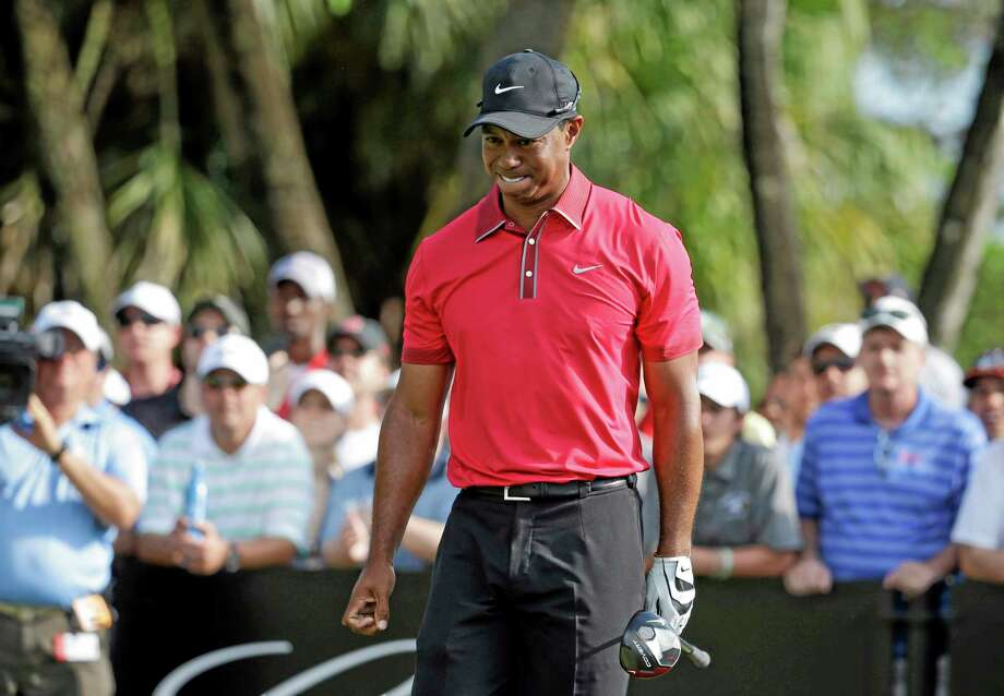 Tiger Woods grimaces after teeing off on the 12th hole during the final round of the Cadillac Championship on March 9 in Doral, Fla. Woods will miss the Masters for the first time in his career after having surgery on his back. Woods said on his website that he had surgery Monday in Utah for a pinched nerve that had been hurting him for several months. Photo: Lynne Sladky — The Associated Press File Photo  / AP