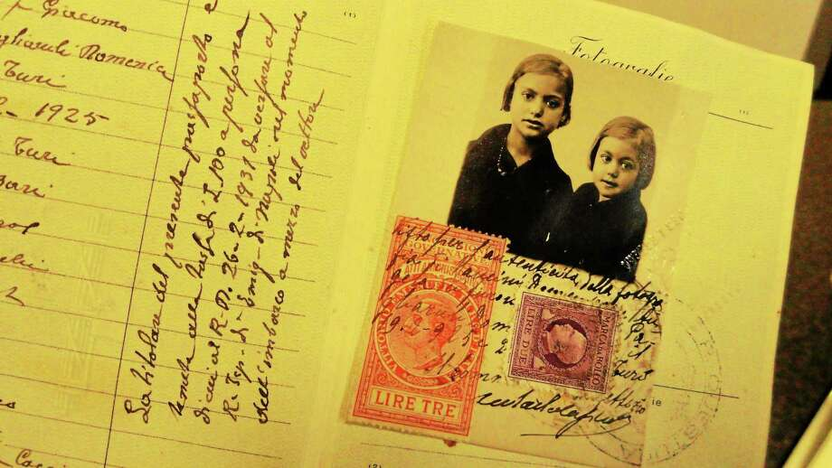 Angela Mancini Chiarappa of Middletown came through Ellis Island from Turi, Italy, at 4 years of age with this passport. Photo: Cassandra Day — The Middletown Press