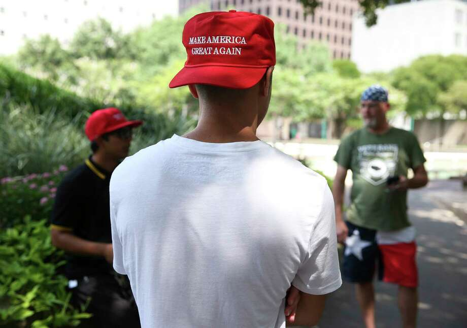 FILE – Proud Boys members gather at Tranquillity Park to counterprotest anti-Senate Bill 4 supporters across the street at Houston City Hall in Houston in this file photo from Saturday, Aug. 12, 2017. Three people were arrested in New York City following violent clashes after a speech by the founder of the far-right group Proud Boys, and police say they are reviewing video and may make additional arrests. Photo: Yi-Chin Lee, Houston Chronicle / © 2017  Houston Chronicle