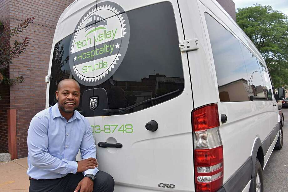 Trent Griffin-Braaf stands next to one of three shuttles he owns on Wednesday Aug. 2, 2017 in Schenectady, N.Y. The Schenectady man went from serving time in prison to working as a hotel janitor to owning his own shuttle business, Tech Valley Hospitality Shuttle. (Lori Van Buren / Times Union) Photo: Lori Van Buren, Albany Times Union / 20041185A