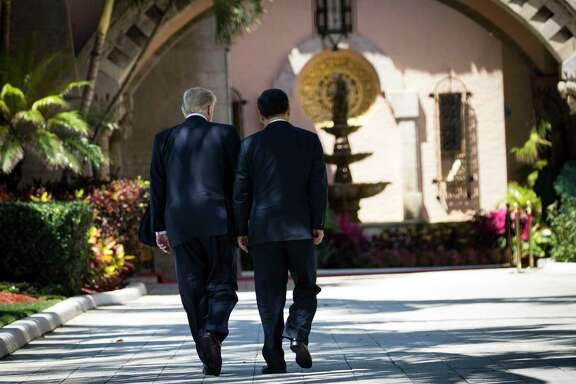 President Donald Trump walks with President Xi Jinping of China in Palm Beach, Fla., in April. In a diplomatic gamble, Trump is seeking to enlist China as a peacemaker in the nuclear-edged dispute with North Korea.