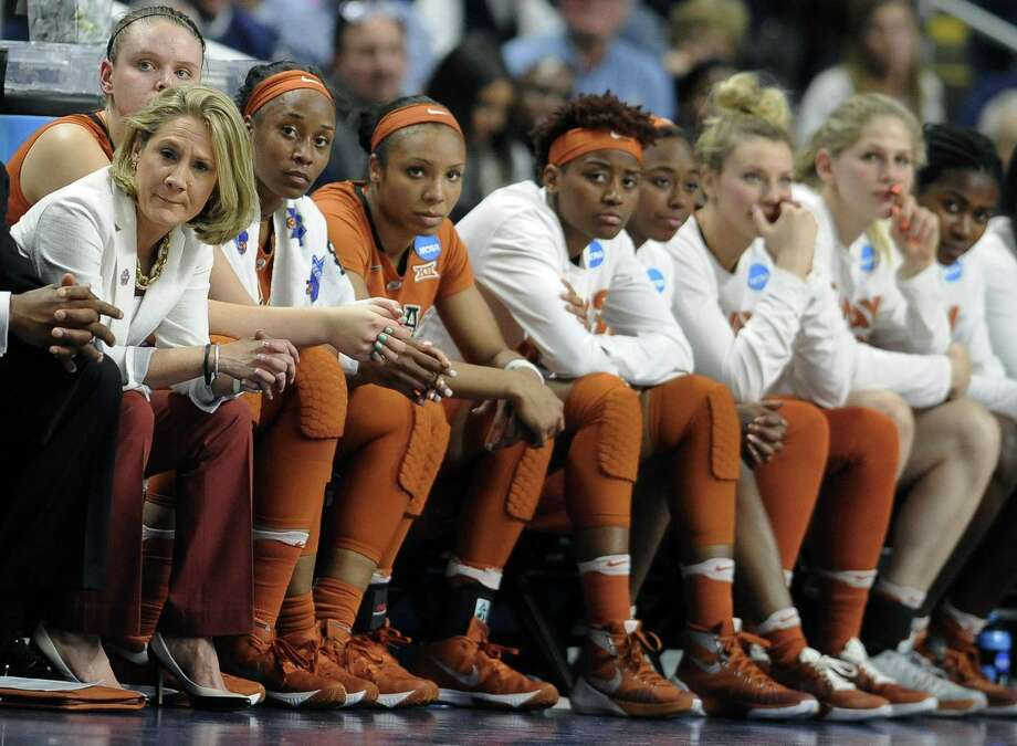 Texas coach Karen Aston (left) and her team watch the end of a loss to Connecticut in the regional final of the NCAA Tournament on March 28, 2016, in Bridgeport, Conn. Photo: Jessica Hill /Associated Press / FR125654 AP