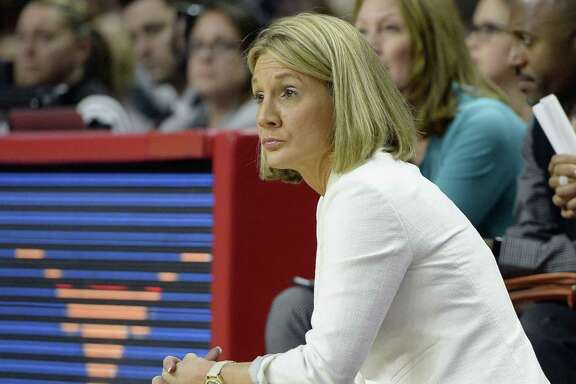 Texas coach Karen Aston watches the second half against Connecticut in the regional final of the NCAA Tournament on March 28, 2016, in Bridgeport, Conn.