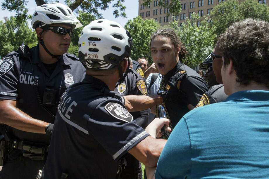 Michael Murphy reacts to being pushed back by police during a rally held by SATX4 to support the removal of the confederate monument in Travis Park in San Antonio, Texas on August 12, 2017. Murphy was apprehended soon after. Texas Freedom Force, a group dedicated to protecting Texas history, hosted a rally to protest the removal of the confederate monument. At the same time, SATX4, a community organization similar to Black Lives Matter, held a counter-protest. Photo: Photos By Carolyn Van Houten / San Antonio Express-News / 2017 San Antonio Express-News