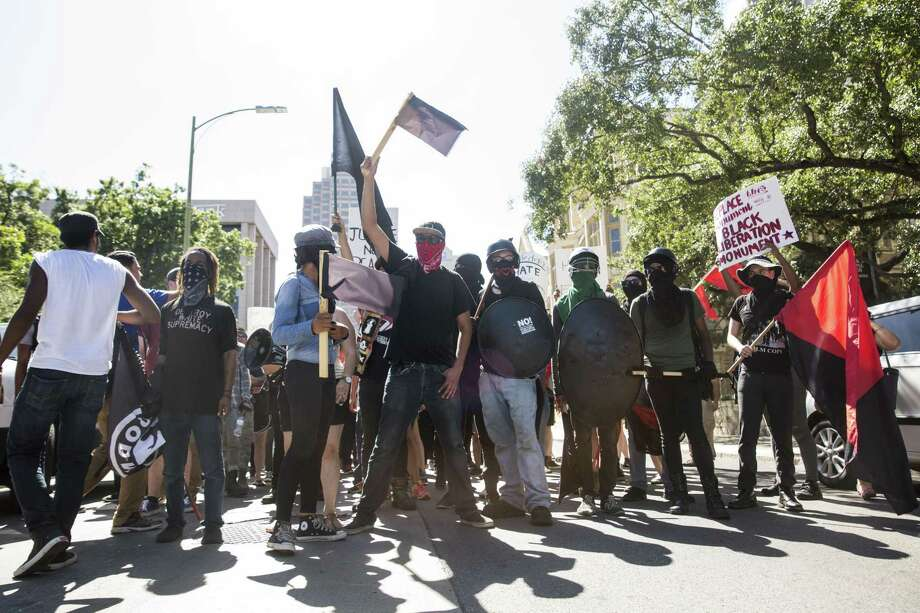 People with the SATX4 rally, in support of the removal of the confederate monument in Travis Park, march along Pecan Street in San Antonio on August 12. Such marches will be easier to accomplish with rules and costs revamped the City Council recently. Photo: Carolyn Van Houten /San Antonio Express-News / 2017 San Antonio Express-News