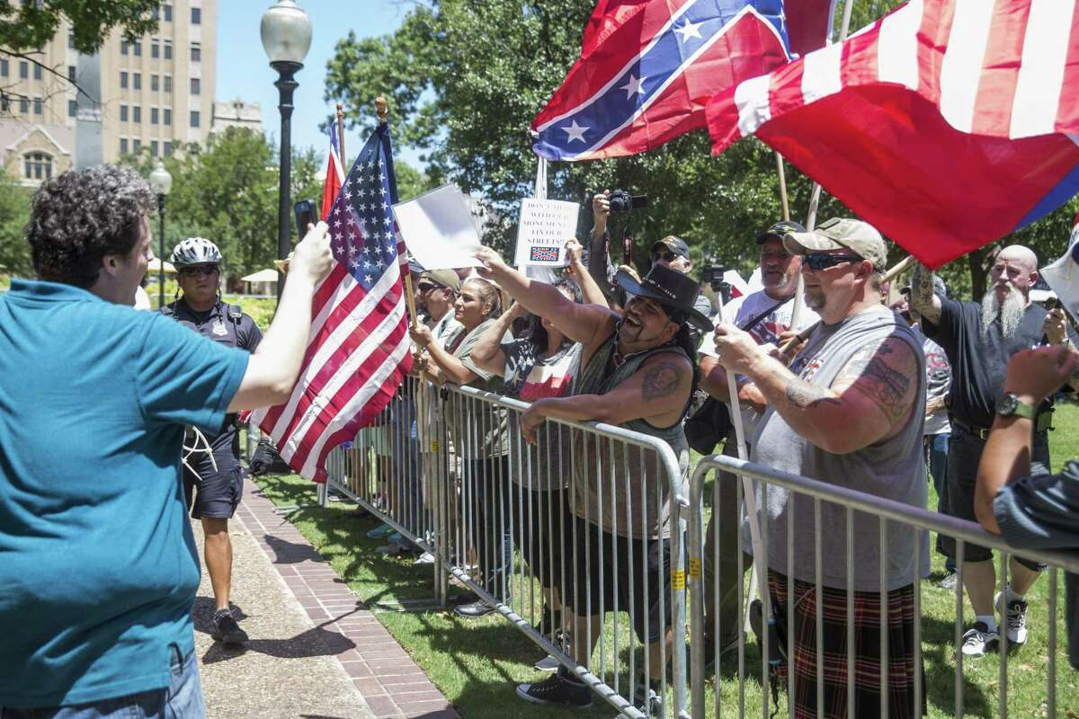 Matthew, left, an attendee of the SATX4 rally, approached and documented during a rally held by Texas Freedom Force to protest the removal of the confederate monument in Travis Park in San Antonio, Texas on August 12, 2017. Texas Freedom Force, a group dedicated to protecting Texas history, hosted a rally to protest the removal of the confederate monument. At the same time, SATX4, a community organization similar to Black Lives Matter, held a counter-protest. Matthew would not provide his last name.