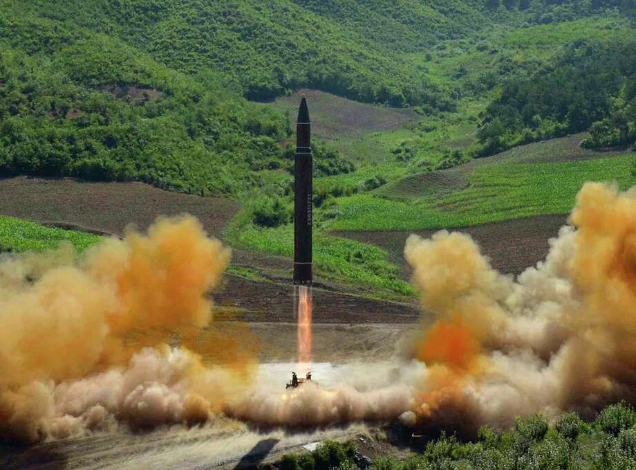 FILE - This file photo distributed by the North Korean government shows what was said to be the launch of a Hwasong-14 intercontinental ballistic missile, ICBM, in North Korea's northwest, Tuesday, July 4, 2017. Independent journalists were not given access to cover the event depicted in this photo. No need to duck and cover just yet. U.S. intelligence officials are pretty sure North Korea can put a nuclear warhead on an intercontinental missile that could reach the United States. Experts aren't convinced the bomb could survive the flight to America. (Korean Central News Agency/Korea News Service via AP, File) ORG XMIT: WX202 / KCNA via KNS