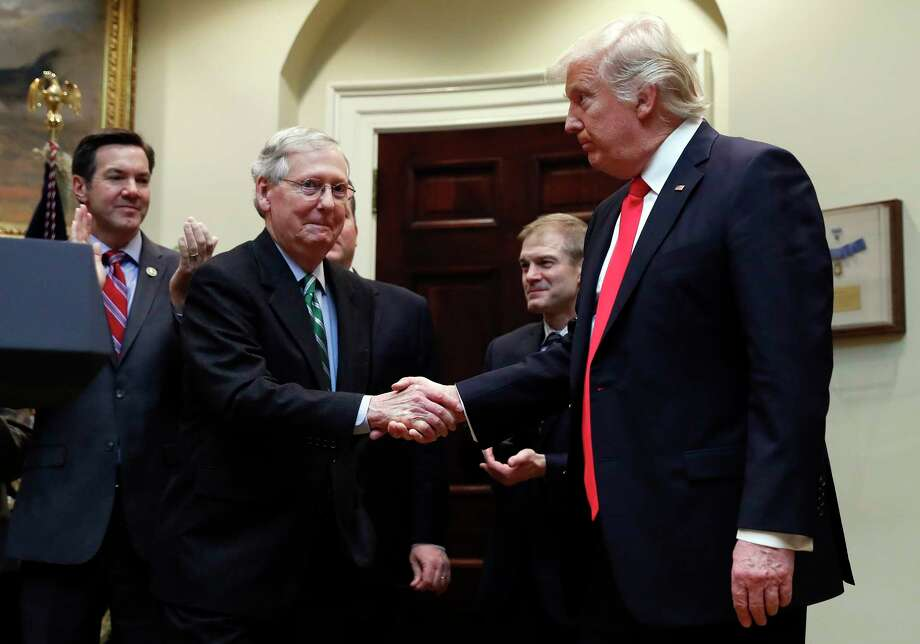 FILE - In this Feb. 16, 2017, file photo, President Donald Trump shakes hands with Senate Majority Leader Mitch McConnell of Ky., during a ceremony in the Roosevelt Room of the White House in Washington. Trump's attacks on McConnell come at the worst possible time, if the president's goal is actually to accomplish the agenda on health care, infrastructure and taxes he's goading his GOP ally to pass. Behind from left are Rep. Evan Jenkins, R-W.Va., and Rep. Jim Jordan, R-Ohio.(AP Photo/Carolyn Kaster, File) ORG XMIT: WX201 Photo: Carolyn Kaster / Copyright 2017 The Associated Press. All rights reserved.