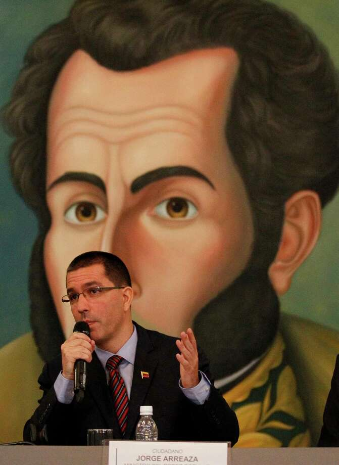 """Venezuela's Foreign Minister Jorge Arreaza speaks during a meeting with the diplomatic corps at his offices in Caracas, Venezuela, Saturday, Aug. 12, 2017. Venezuela's government is energetically rejecting US President Donald Trump's talk of a """"military option"""" to resolve the country's political crisis, calling it the most-egregious act of belligerence against the country in a century and a threat to Latin America's stability. The picture at the background is the Venezuelan hero Simon Bolivar (AP Photo/Ariana Cubillos) ORG XMIT: XFLL106 Photo: Ariana Cubillos / Copyright 2017 The Associated Press. All rights reserved."""