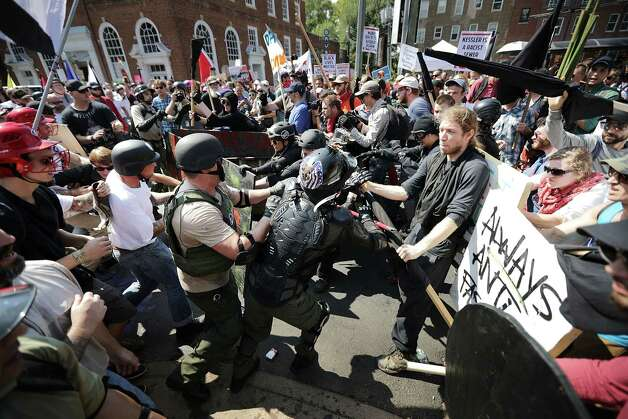 "White nationalists, neo-Nazis and members of the ""alt-right"" clash with counterprotesters as they enter Lee Park during the ""Unite the Right"" rally on Saturday in Charlottesville, Va. Photo: Chip Somodevilla, Staff / 2017 Getty Images"