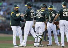 Oakland Athletics manager Bob Melvin, left, removes pitcher Sean Manaea during the first inning of a baseball game against the Baltimore Orioles on Saturday, Aug. 12, 2017, in Oakland, Calif. (AP Photo/Ben Margot)