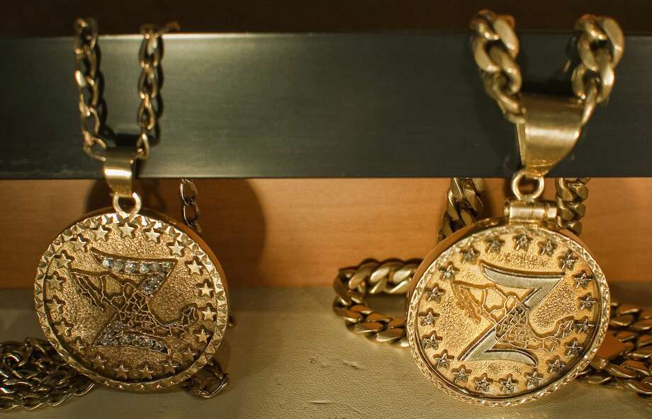 In this file photo, two medals of the Zetas drug cartel are on display at the Museum of Drugs in Mexico City. Gold-incrusted weapons, children clothes decorated with LSD-laced stickers and religious paintings packed with cocaine offer a glimpse into Mexico's growing drug culture in a unique museum. Photo: Ronaldo Schemidt/AFP/Getty Images