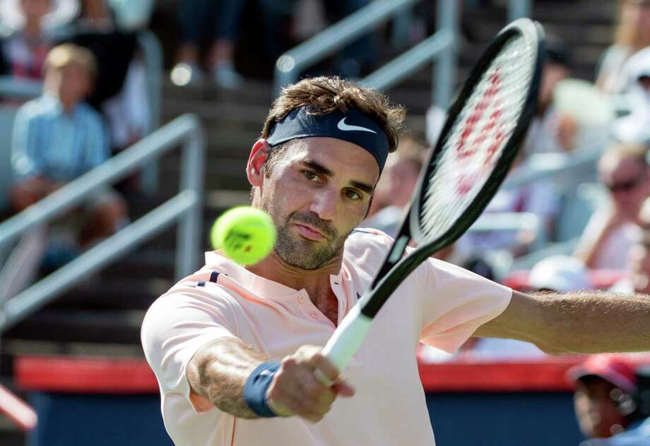 No. 2 seed Roger Federer returns the ball in Saturday's 6-3, 7-6 (5) victory over unseeded Robin Haase to advance to the Rogers Cup final in Montreal. Photo: Paul Chiasson, SUB / The Canadian Press