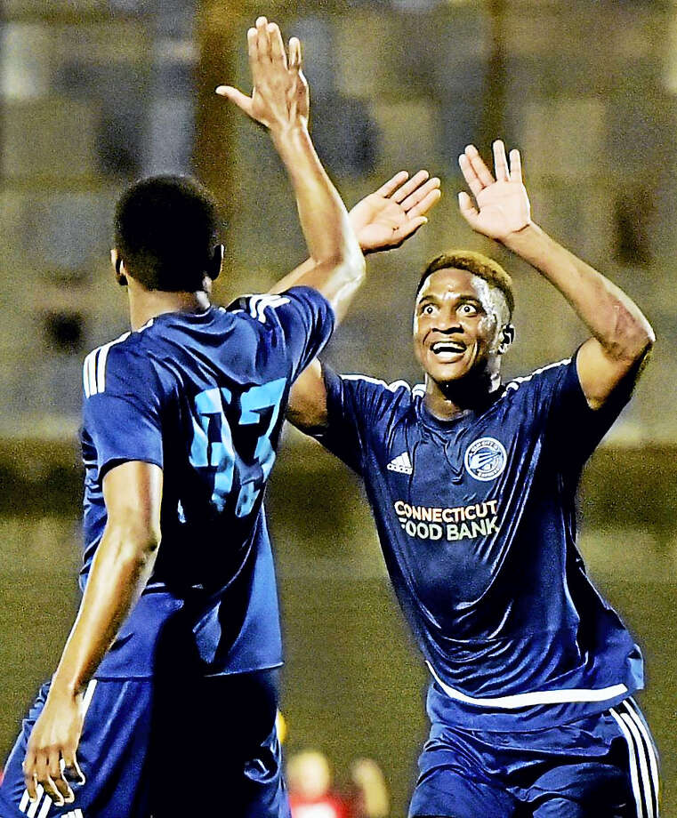 Tavoy Morgan of the Elm City Express, right, is congratulated by teammate Shaquille Saunchez after scoring the first goal against the Midland-Odessa FC in Saturday's NPSL championship game in New Haven. Photo: Peter Hvizdak/Hearst Connecticut Media / New Haven Register