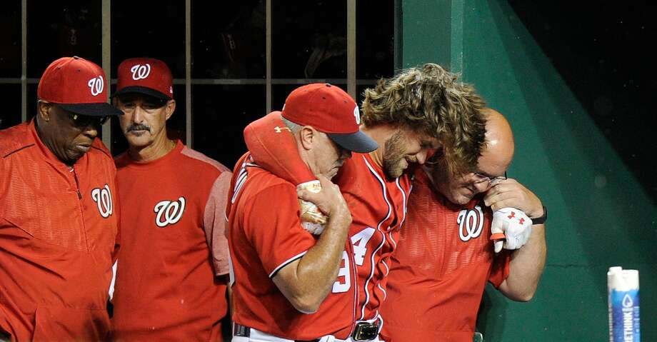 WASHINGTON, DC - AUGUST 12:  Bryce Harper #34 of the Washington Nationals is helped into the locker room after injuring his leg in the first inning against the San Francisco Giants at Nationals Park on August 12, 2017 in Washington, DC.  (Photo by Greg Fiume/Getty Images) Photo: Greg Fiume/Getty Images