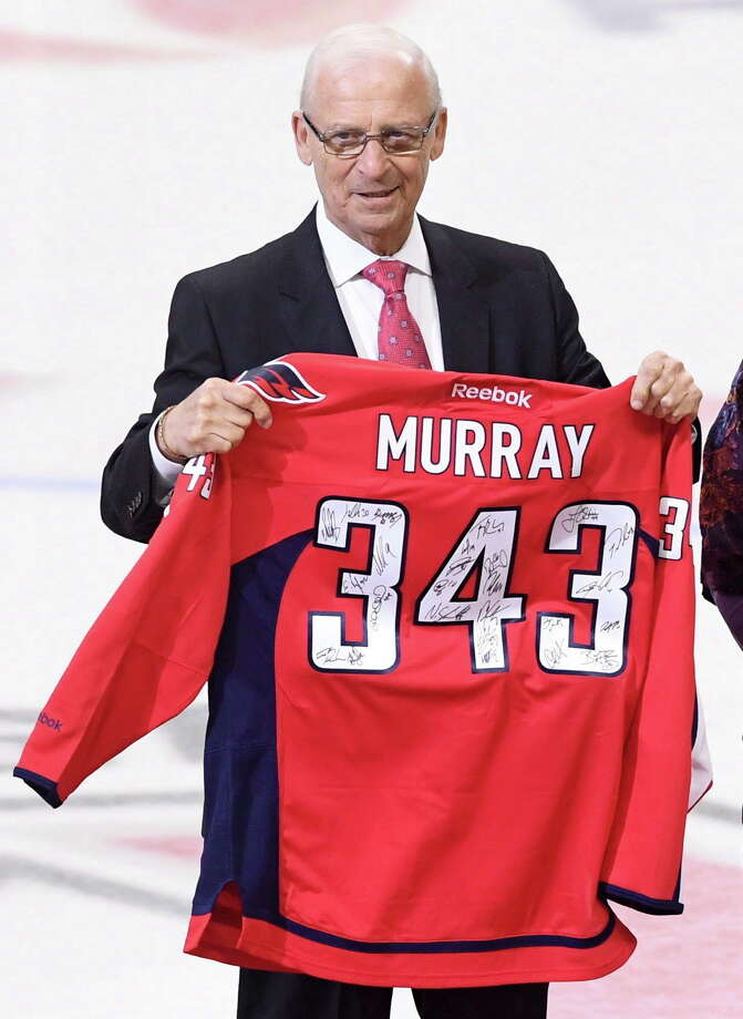 "This Jan. 24, 2017 photo shows senior hockey advisor to the Ottawa Senators, Bryan Murray, holding a signed Washington Capitals jersey as he is inducted as the first member of the Ottawa Senators new ""ring of honour,"" in Ottawa. The Ottawa Senators say former NHL coach and general manager Bryan Murray has died at age 74. He was diagnosed with stage 4 colon cancer in 2014. (Sean Kilpatrick/The Canadian Press via AP) ORG XMIT: CPT102 Photo: Sean Kilpatrick / The Canadian Press"