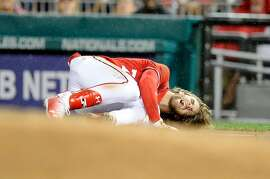 WASHINGTON, DC - AUGUST 12:  Bryce Harper #34 of the Washington Nationals on the ground in pain after injuring his leg in the first inning against the San Francisco Giants at Nationals Park on August 12, 2017 in Washington, DC.  (Photo by Greg Fiume/Getty Images)