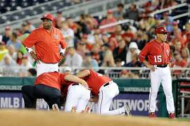 WASHINGTON, DC - AUGUST 12:  Manager Dusty Baker #12 of the Washington Nationals looks on as Bryce Harper #34 is attended to after an injury in the first inning against the San Francisco Giants at Nationals Park on August 12, 2017 in Washington, DC.  (Photo by Greg Fiume/Getty Images)