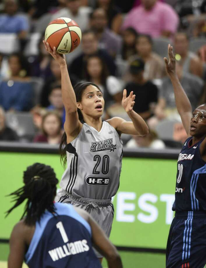 Isabelle Harrison the San Antonio Stars (20) shoots and scores against Sancho Lyttle, right, and Elizabeth Williams (1) of the Atlanta Dream during WNBA action at the AT&T Center on Saturday, Aug. 12, 2017. Photo: Billy Calzada, Staff / San Antonio Express-News / San Antonio Express-News