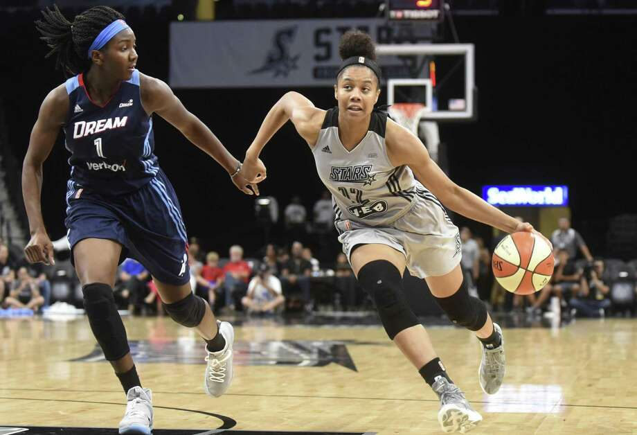 Nia Coffey of the Stars drives as Elizabeth Williams of the Atlanta Dream gives chase during second-half action at the AT&T Center on Aug. 12, 2017. Photo: Billy Calzada /San Antonio Express-News / San Antonio Express-News