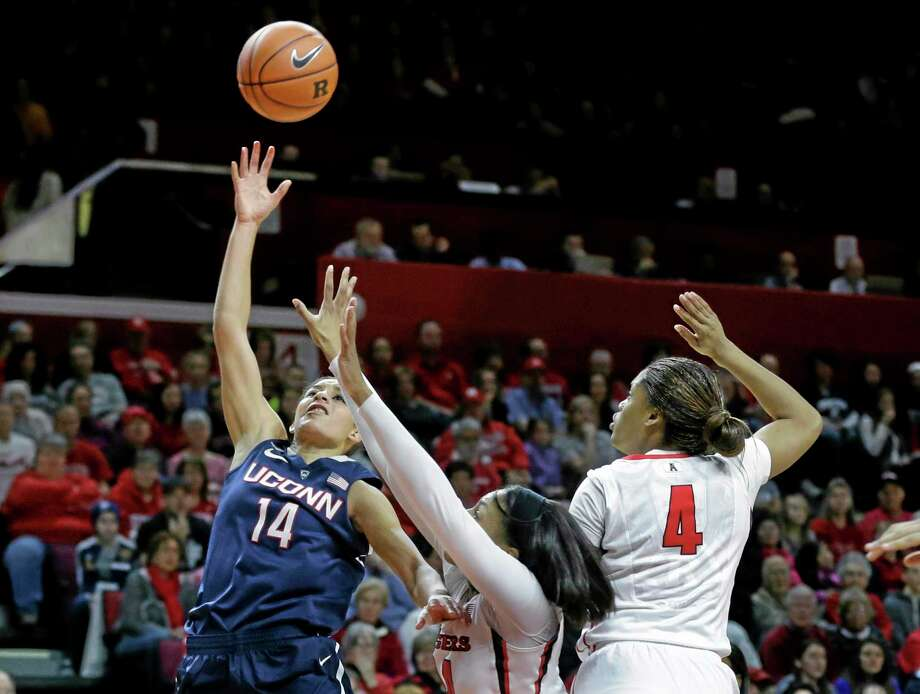 Connecticut guard Bria Hartley (14) takes a shot as she drives past Rutgers forward Betnijah Laney and guard Briyona Canty (4) during the first half of an NCAA women's college basketball game, Sunday, Jan. 19, 2014, in Piscataway, N.J. Hartley had 30 points in Connecticut's 94-64 win. (AP Photo/Mel Evans) Photo: AP / AP